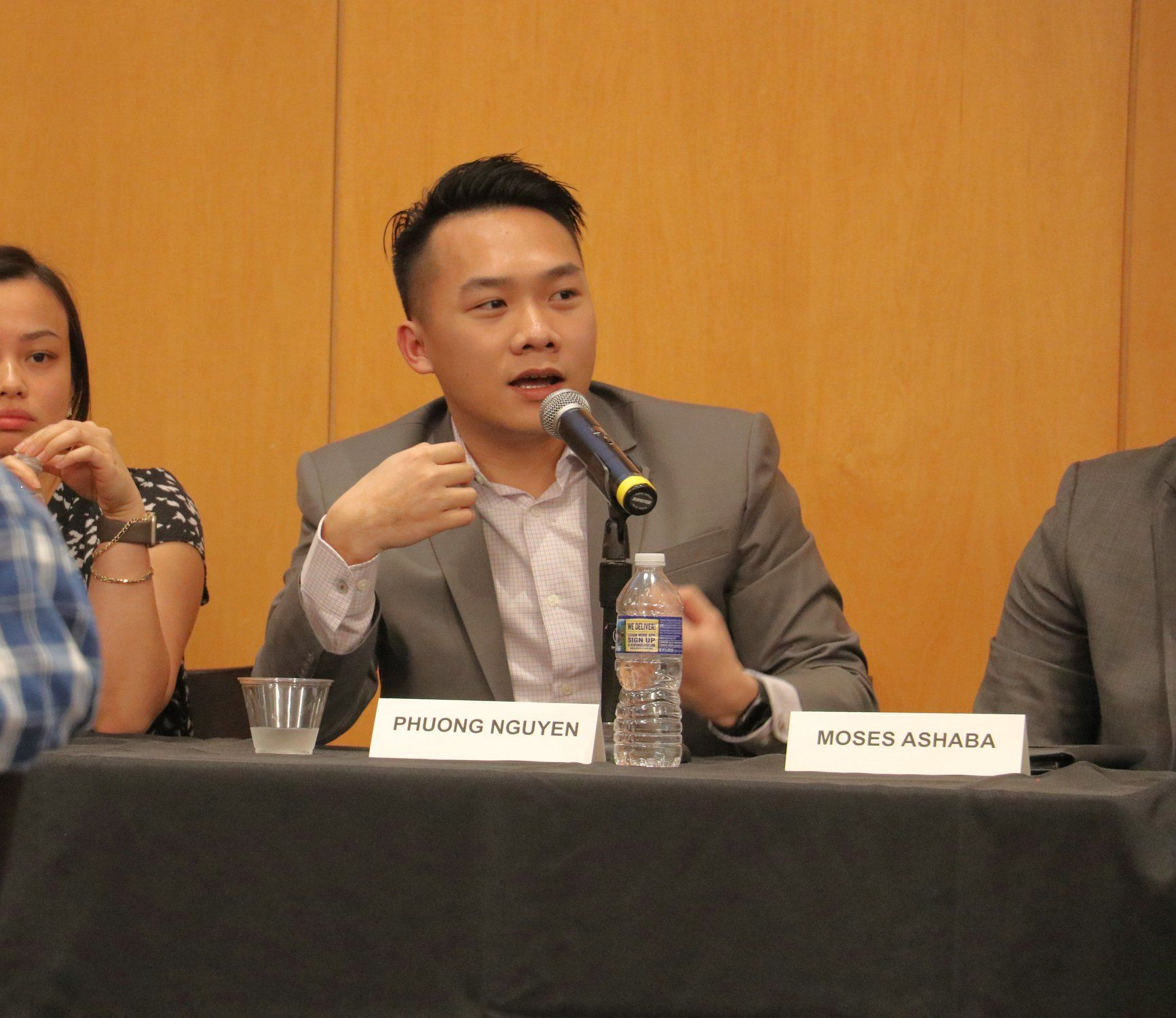 Student speaking during a panel discussion