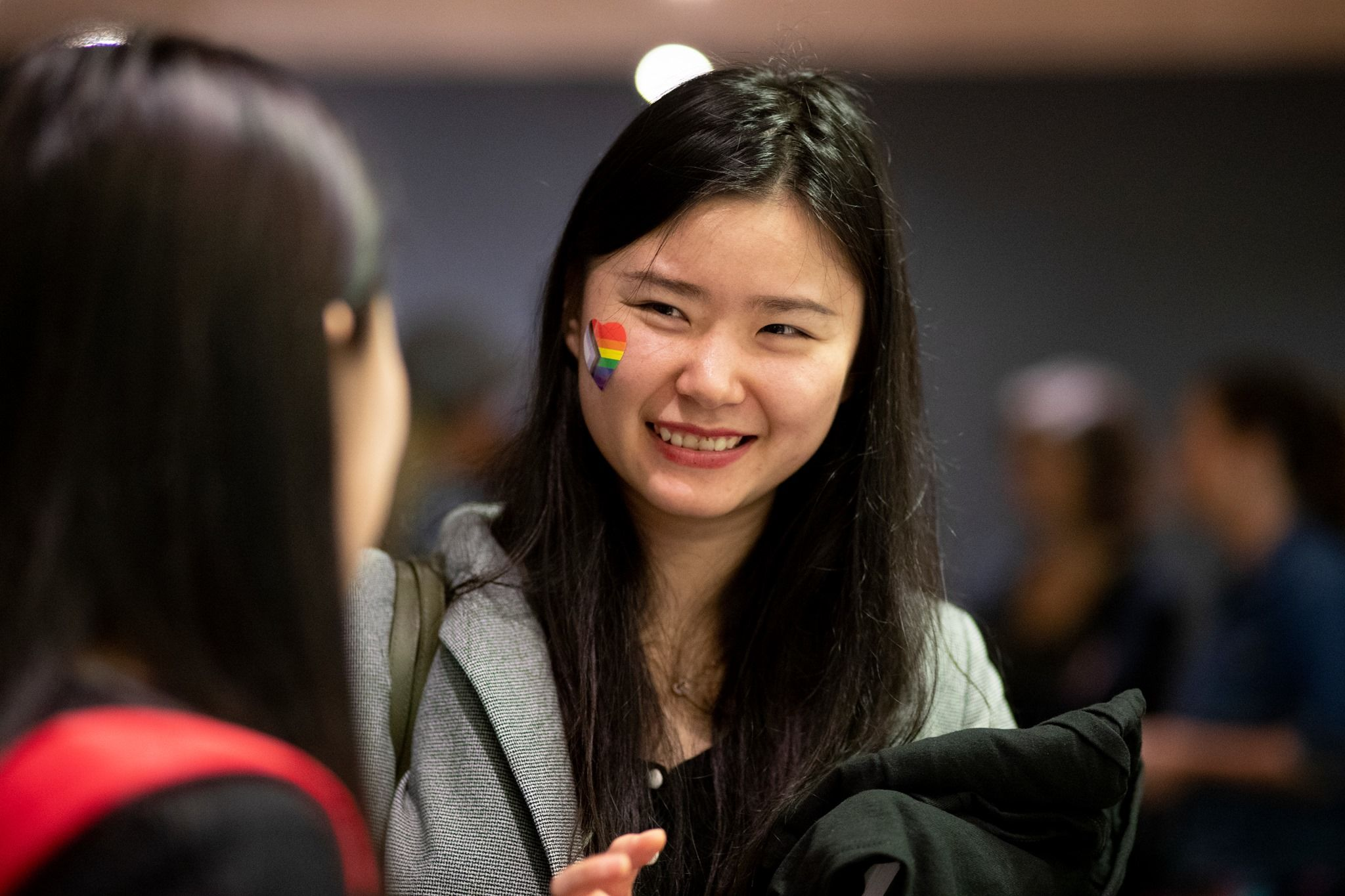 Student smiling during conversation