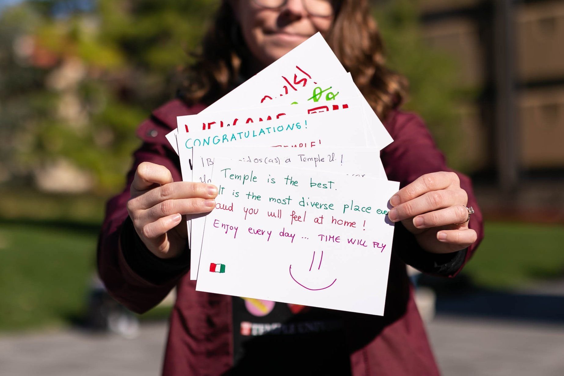 #YouAreWelcomeHere Week Kick-Off. Woman holding hand-written postcards.
