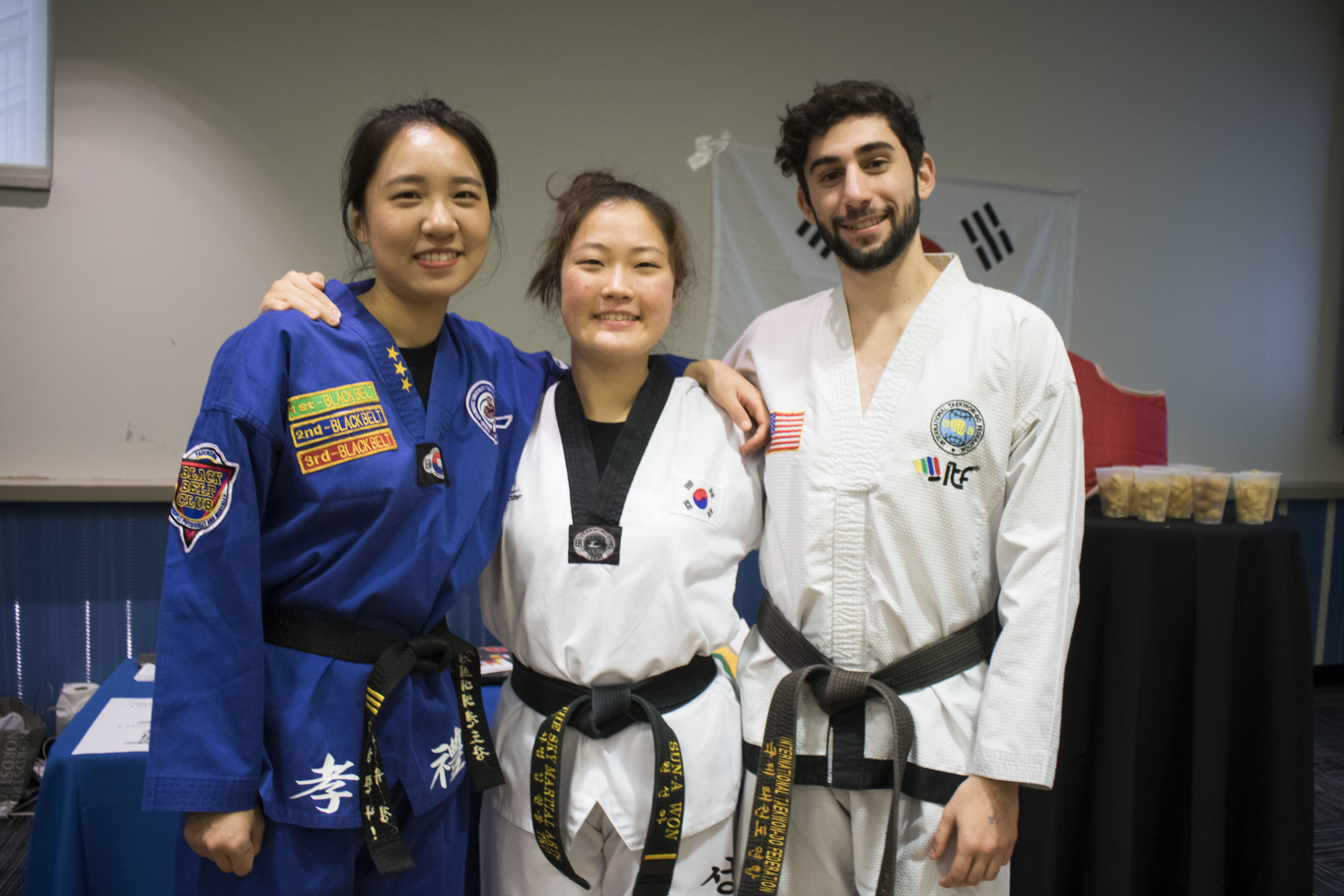 Students in martial arts robes  smiling